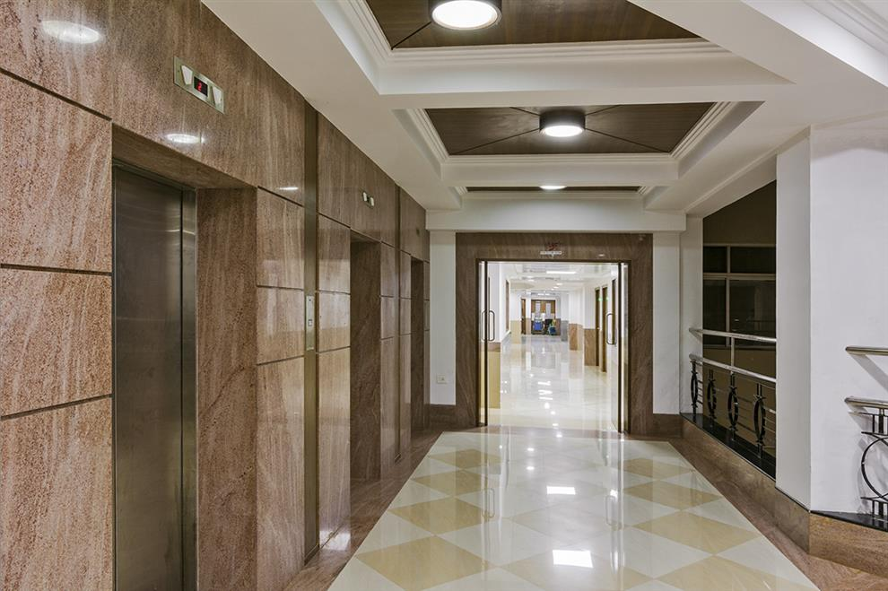 Bakir baldiwala health care facility lift lobby for Villa lobby interior design